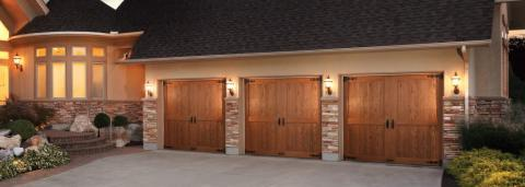 Rustic Garage with barn door style garage door