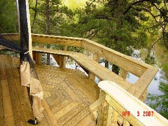 Bay deck with bench railing pictures and photos