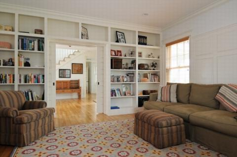 Transitional Family Room with built in wood book case