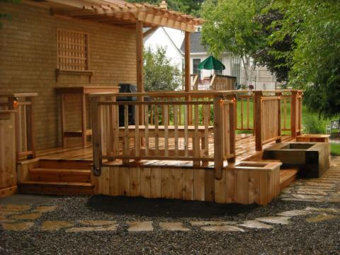 Transitional Deck with small light wood trellis