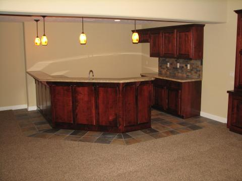 Transitional Bar with dark brown tile back splash