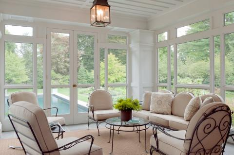 Transitional Sunroom with taupe upholstered cushions