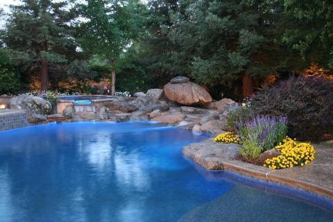 Transitional Pool with water fall feature in pool