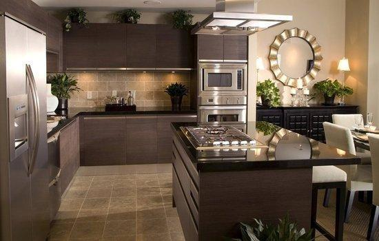 Modern Kitchen with light beige tile back splash