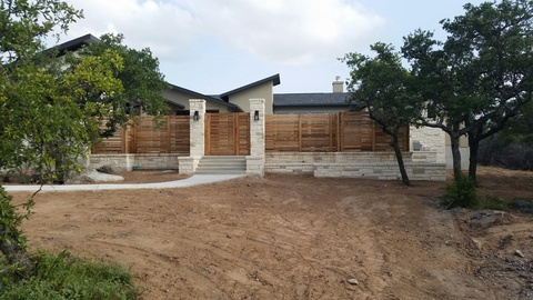 Modern Landscape with cut stacked stone retaining wall veneer