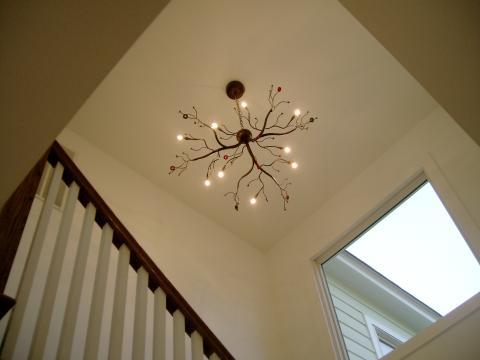 Modern Entry with free form chandelier