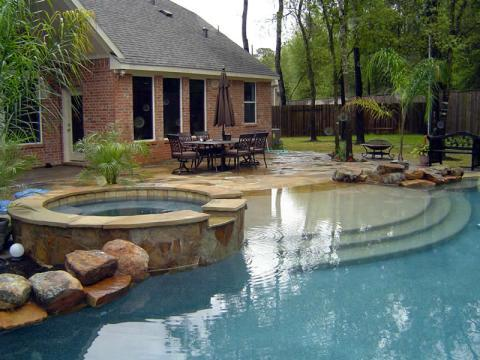 Transitional Pool with hot tub connected to pool