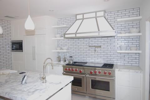 Eclectic Kitchen with white subway tile accent walls