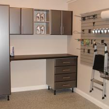 Transitional Garage with silver metal desk and cabinets