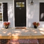 Colonial Porch with black exterior shutters
