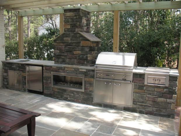 Traditional Outdoor Kitchen with stainless steel appliances