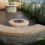 Contemporary Patio with stone in ground fire pit
