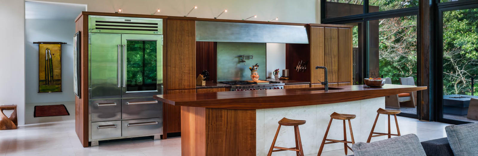 Modern Kitchen with brushed metal bridge and hood