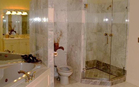 Traditional Master Bathroom with clear glass shower door