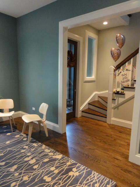 Eclectic Entry with white and blue area rug