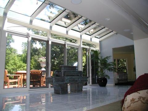 Eclectic Sunroom with green marble water feature
