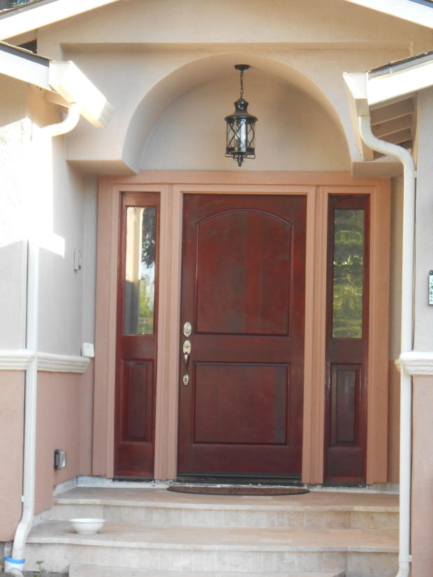Tuscan Patio with stained wood front door