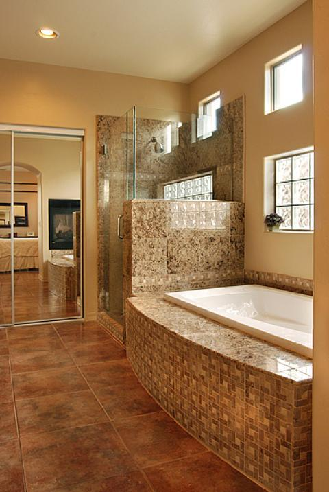 Transitional Bathroom with brown granite tile shower wall covering