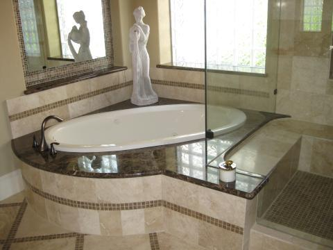 Traditional Master Bathroom with built in tile shower seat