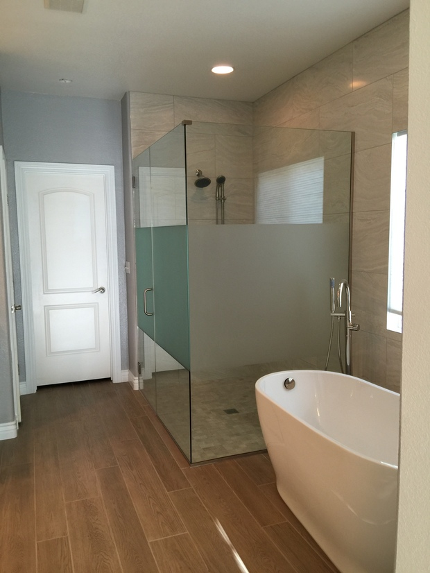Transitional Bathroom In Las Vegas White Wood Baseboards Free Standing Bathtub By Home Masters
