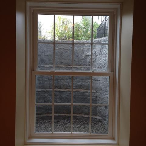 Traditional Basement with single hung window
