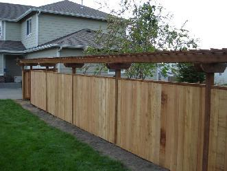 Cedar fence pictures and photos for Fence with arbor