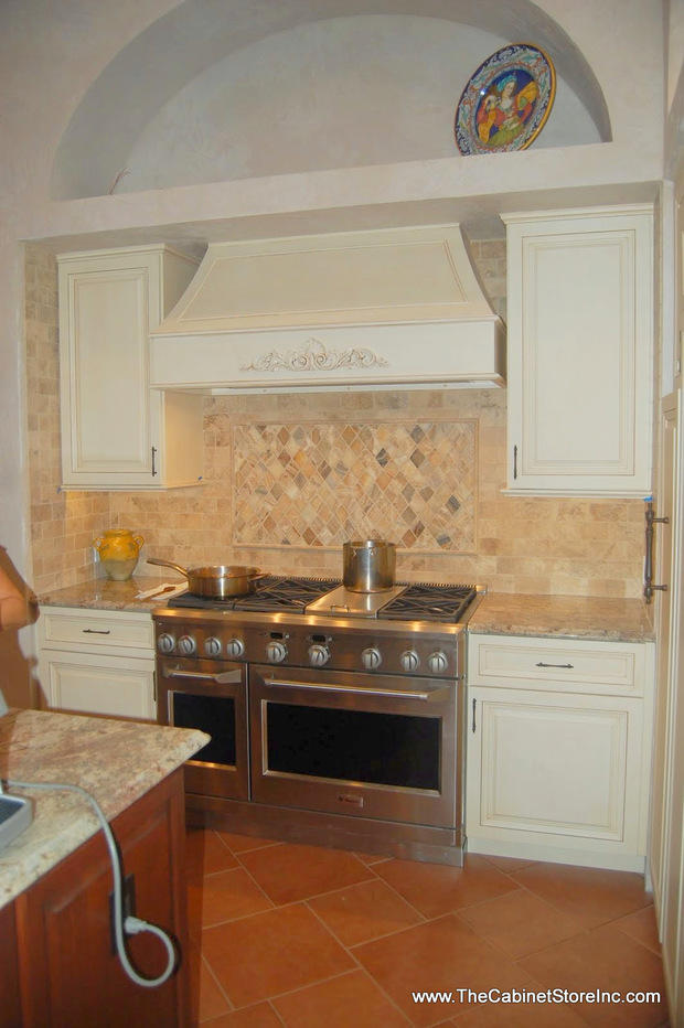 French Country Kitchen With Maple Cabinets french country kitchen in valrico - diamond pattern tile inlay