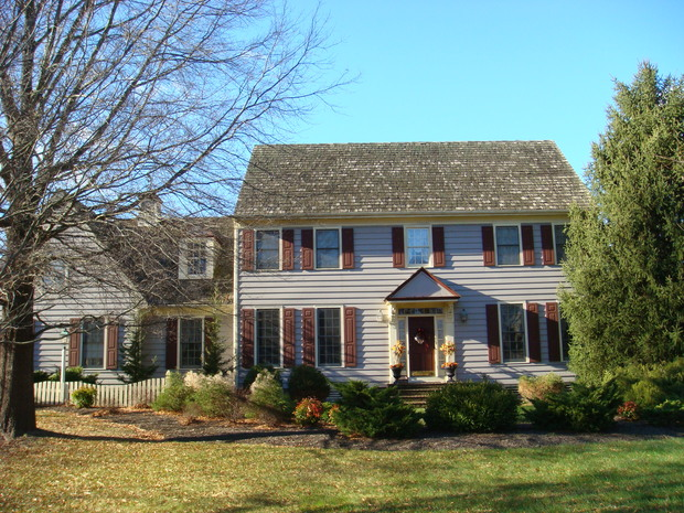 Colonial home exterior in feafterville centered front door white siding by mid atlantic for Mid atlantic gutters and exteriors