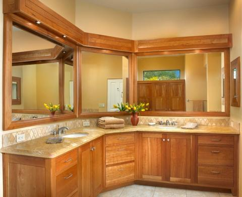 Traditional Master Bathroom with light wood framed vanity mirrors