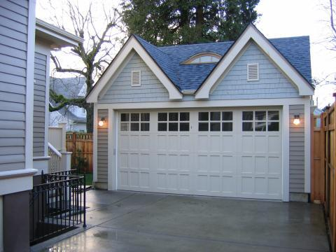 Traditional Garage with white garage exterior trim