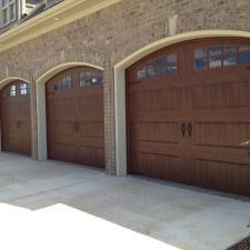 Transitional Garage with garage doors with windows
