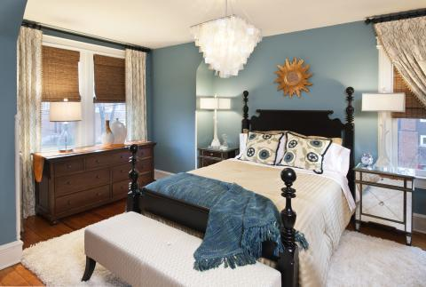 Eclectic Bedroom with blue and ivory bed linens