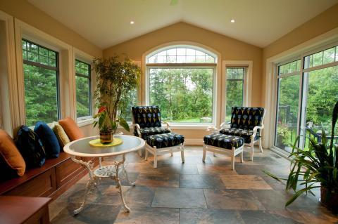 Traditional Sunroom with white framed windows and doors