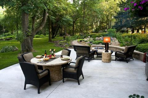 Contemporary Patio with wicker style outdoor lounge furniture