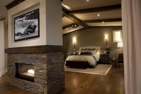 Contemporary Bedroom with dark wood ceiling beams
