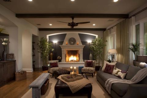 Transitional Family Room with wrought iron fire place screen