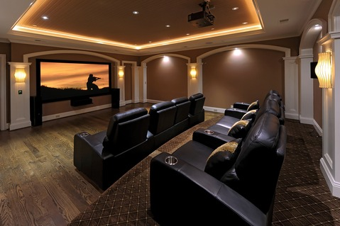 Transitional Home Theater with black leather theater seat