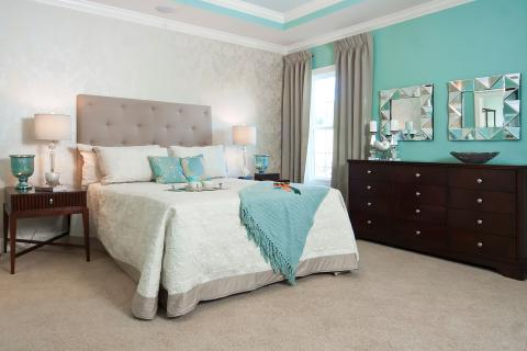 Transitional Bedroom with light gray upholstered head board