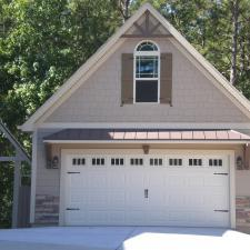 Arts & Crafts Garage with white framed windows and doors