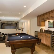 Traditional Basement with black felt top on pool table