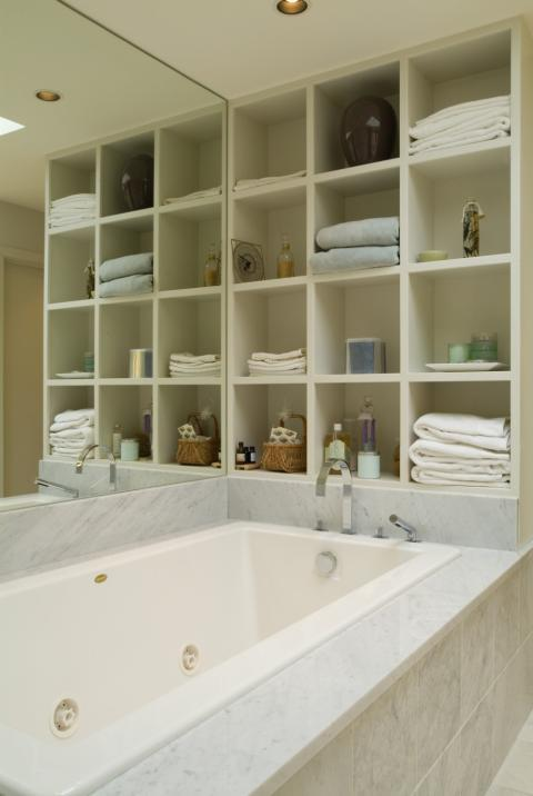Transitional Bathroom with marble tile tub surround
