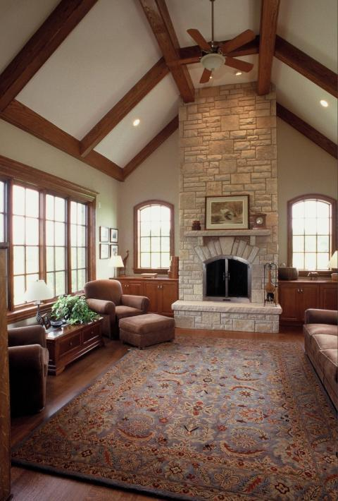 Traditional Family Room with light brown suede sofa and arm chair with ottoman