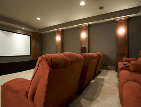 Traditional Home Theater with wall mounted projector screen