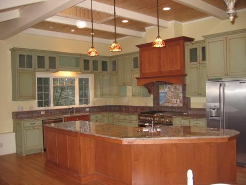 Eclectic Kitchen with stained wood cabinets on island