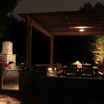 Contemporary Outdoor Kitchen with outdoor lighting