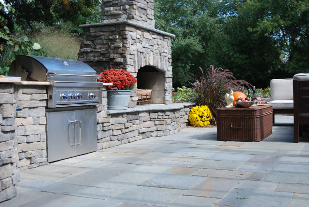 Traditional Outdoor Kitchen with dark brown outdoor patio furniture