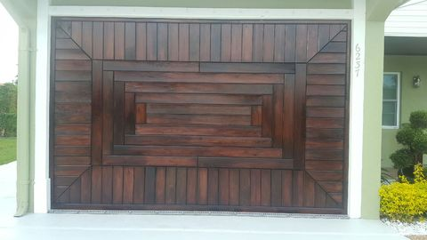 Eclectic Garage with wood work on garage door