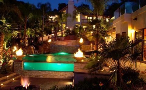 Contemporary Pool with great outdoor lighting