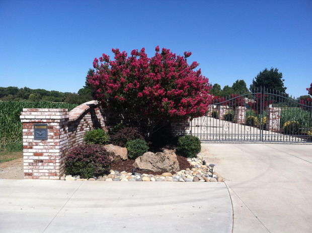 Traditional driveway in hayward brick wall wrought iron for Landscaping rocks myrtle beach