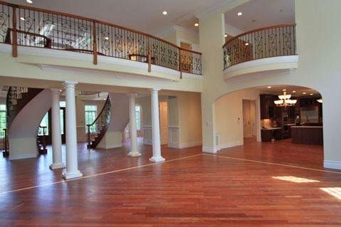 Traditional Family Room with second story balcony